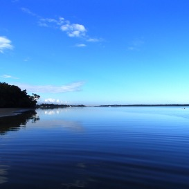 Blue sky and calm waters